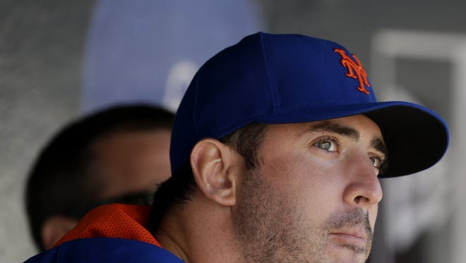 New York Mets' Matt Harvey sits in the dugout during the seventh inning of the baseball game against the Washington Nationals on Opening Day at Citi Field in New York, Monday, March 31, 2014.