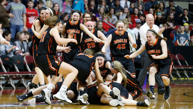 Springville players pile onto the court Friday, March 4, 2016, as they get the win over Turkey Valley in the 1A state finals at Wells Fargo Arena in Des Moines.