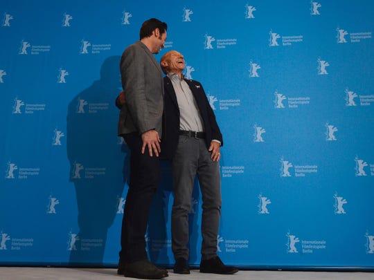 Patrick Stewart shares a laugh with Hugh Jackman.