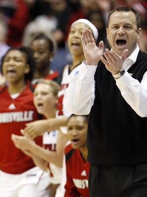 Jeff Walz, head coach of University of Louisville and the bench cheer as the Lady Cards lead  Vanderbilt University during the NCAA first round of game 1 at Cintas Center in Cincinnati. Photo shot Sunday March 20, 2011.
