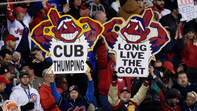 Cleveland Indians fans hold up signs at Progressive Field.