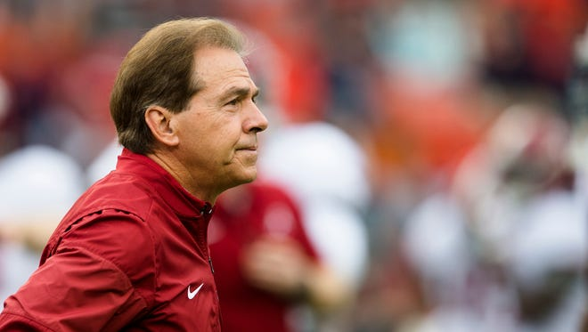 Alabama head coach Nick Saban walks the field before the Iron Bowl NCAA football game between Auburn and Alabama on Saturday, Nov. 25, 2017, in Auburn, Ala.