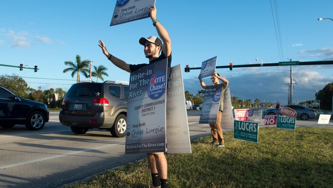 Chase Lurgio, a write-in candidate for the Martin County Commissioner District 1 seat, campaigns in front of the North Stuart Baptist Church on Tuesday, Nov. 8, 2016, in Stuart. Lurgio's opponent was Doug Smith.