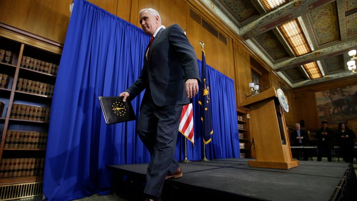 Indiana Gov. Mike Pence steps off the podium after