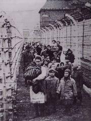 Holocaust survivor Eva Kor, at age 10 in front middle,