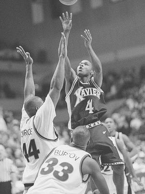 Lenny Brown's buzzer-beating shot lifted Xavier over  then-No. 1 Cincinnati in the 1996 edition of the Crosstown Shootout.
