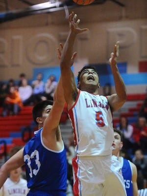 Lincoln's Isaiah Roach goes up for a shot while O'Gorman's Ben Lauer defends during their game at Lincoln High School on Tuesday, Feb. 17, 2015.