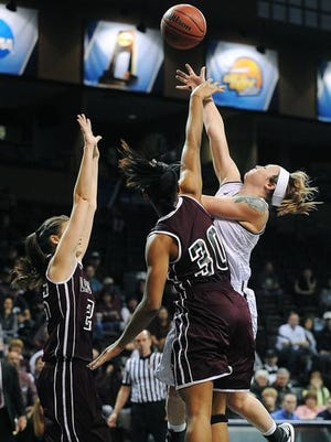 Emporia State's Megan Holloway (14) goes up for a shot as West Texas A&M's Zantaya Davis (30) defends during a NCAA Division II Women's Basketball Championship Tournament quarterfinal game on Tuesday, March 24, 2015, at the Sanford Pentagon in Sioux Falls. Emporia State defeated West Texas A&M 62 to 50.