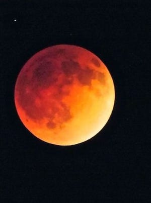 A lunar eclipse will occur Sunday night, giving the moon a red, coppery tint.