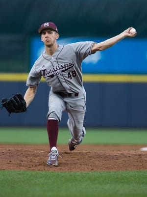 Mississippi State's Ross Mitchell (48) releases a pitch in the second inning. Mississippi State and Ole Miss played in a college baseball game at Trustmark Park in Pearl on Tuesday.