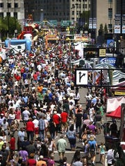 Thousands gathered on Fifth Street during Taste of Cincinnati in 2015.