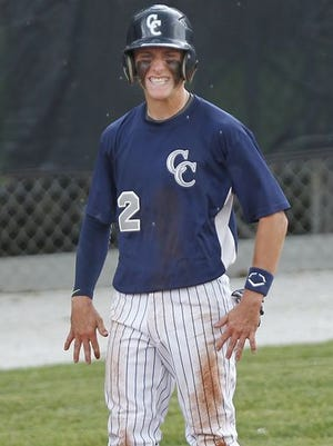 Adam Lovell grins after scoring on Dylan Kiracofe's double with two outs in the bottom of the first inning against Lewis Cass in the 2A baseball semistate Saturday, June 13, 2015, at CFD Investment Stadium in Kokomo. Lovell's score put CC up 1-0 at the time. CC defeated Lewis Cass 4-1