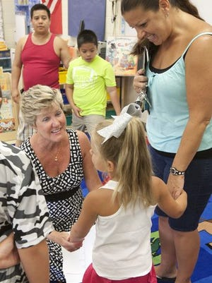 East Dover Elementary School kindergarten teacher Jaclyn Lomer meets one of her new students, Sofi, Zydzik, 5, who was with her mother, Veronica.