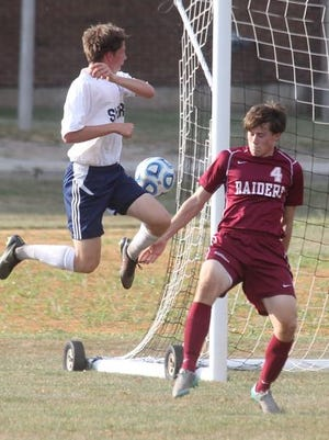Suffern's Zac Lloyd, left, tries to flip the ball past Scarsdale defender Max Bryant during their game at Suffern Sept. 9, 2015. Scarsdale won 1-0.
