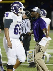 Fremont Ross coach Craig Yeast speaks with offensive
