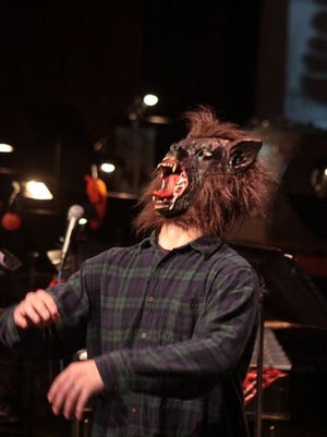 A wolfman howls along with the performers at the 2014 Percussion Ensemble Halloween Concert.