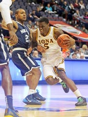 A.J. English (5) drives to the basket during Iona's