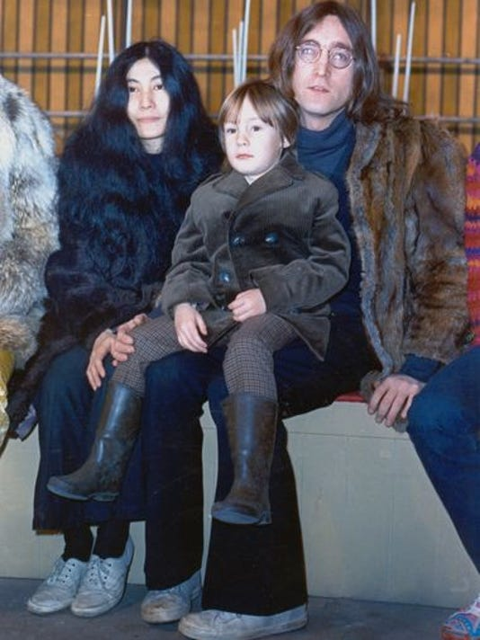 Lennon poses with his son Julian and Yoko Ono at an unknown location in 1968.