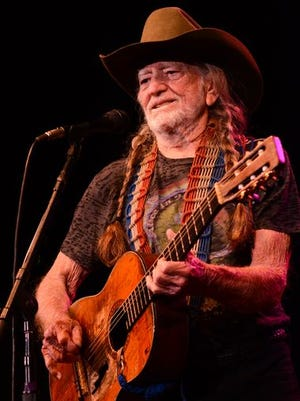 Willie Nelson joined opener Merle Haggard at the end of his set, then took the stage later in the night. He was joined by Haggard for several songs.