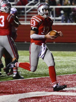 Bellevue quarterback Alec Foos runs into the end zone against Shelby earlier this season.