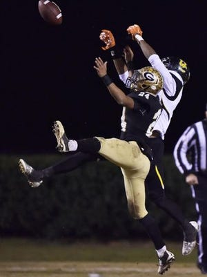 Greer's Adrian McGee (24) goes up for a pass against Union during a Class AAA playoff game at Dooley Field.