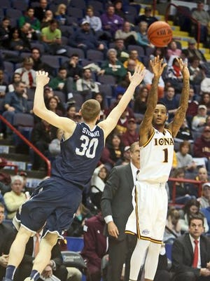 Iona's Isaiah Williams shoots from 3-point range during Iona's 95-77 win over Monmouth in a MAAC Championship semifinal game at the Times Union Center in Albany March 8, 2015. Iona will host Monmouth at 9 p.m. on Jan. 15.