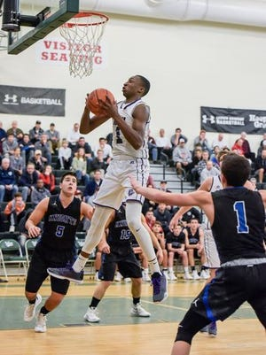 Rumson-Fair Haven sophomore forward Elijah McCallister goes up for a rebound against Gill St. Bernard's at the Boardwalk Hoop Group Showcase on Jan. 9, 2016 at Long Branch High School
