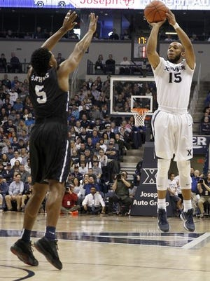 Myles Davis (right) and No. 7 Xavier host DePaul at 6:30 p.m. Tuesday in a Big East game at Cintas Center.