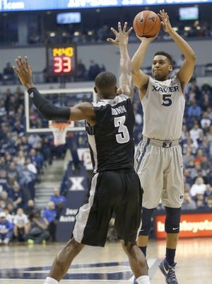 Providence guard Kris Dunn, shown here guarding Xavier's Trevon Bluiett last season, is a driving force for the No. 10 Friars. Seventh-ranked Xavier faces Providence at 8:30 p.m. Tuesday in Rhode Island.