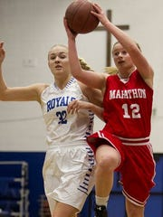 Marathon's Jayci Blume drives past Assumption's Gena Grundhoffer during a game earlier this winter. Both teams received top seeds for the WIAA girls basketball ostseason