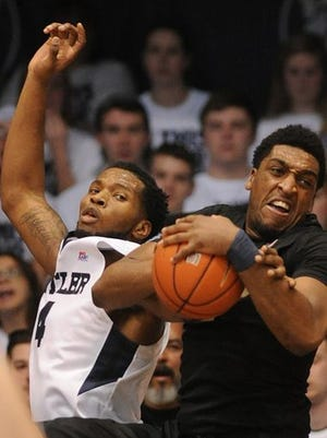 Senior forward James Farr (right) and Xavier tied Michigan State for eighth in Monday's Associated Press Top 25. The Musketeers came in seventh in the USA Today Coaches Poll.