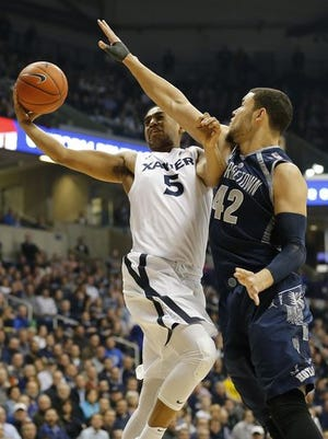 Georgetown's Bradley Hayes, shown here defending Xavier's Trevon Bluiett, broke his left hand and will not be playing in Saturday's rematch in Washington, D.C. The Hoyas won Game One (81-72) at Cintas Center in January.