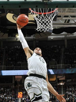 Denzel Valentine and Michigan State move up a few spots in the coaches and Associated Press polls this week.