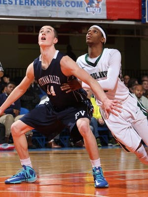 Putnam Valley's Joe Spinola (left) compete for a rebound against Woodlands in the 2015 Class B semifinals at the County Center. Woodlands beat Putnam Valley 68-56 on Feb. 25, 2015.