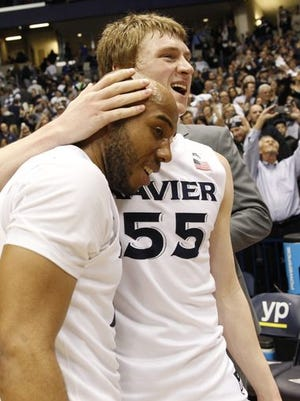 Myles Davis (left) and J.P. Macura helped No. 5 Xavier to a Wednesday victory over No. 1 Villanova but said there's still much work to be done this season.