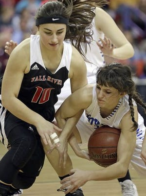 Assumption guard Autumn Linzmeier (20) fights for a loose ball against Fall River guard Elizabeth Soter (10) in the Division 5 WIAA State Girls basketball semifinal at the Resch Center in Green Bay on Friday.