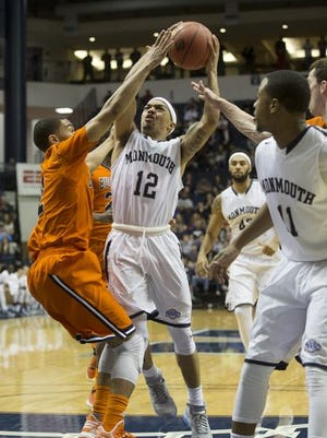 Justin Robinson drives to the hole during Monmouth's 90-80 win over Bucknell on Wednesday. The Hawks host George Washington on Monday in the second round of the NIT.