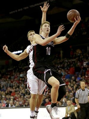 SPASH's Sam Hauser drives to the basket during the WIAA Division 1 boys state basketball title game Saturday