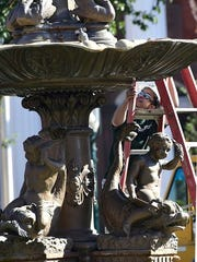 In this file photo, Art Research Enterprises move the Chambersburg Memorial Fountain in October. The fountin is being refurbished at he Lancaster company and will be returned to the square next week. Markell DeLoatch