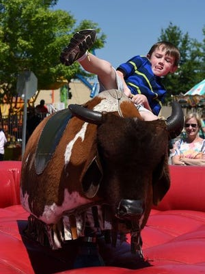 Children and adults took turns on the mechanical bull at the Pelham Medical Center Greer Family Fest last year.