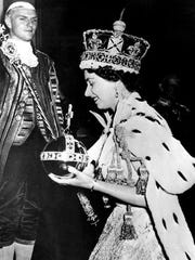 She became queen in February 1952, after King George VI died, and was crowned in June 1953. She wore the bejeweled Imperial Crown and carried the Orb and Scepter with Cross as she left Westminster Abbey at the end of the long, traditional Coronation Ceremony.  Associated Press