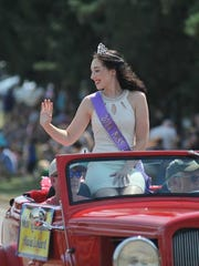 Miss Lexington waves to the crowd at the 2015 Lexington Blueberry Festival.