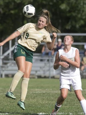 Girls soccer--Brick Memorial at Southern. Brick #19 Angel Hernandez heads the ball in front of Southern #5 Megan Lockwood—September 12, 2016-Stafford, NJ.-Staff photographer