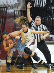 Union CO. Kiara Campbell and Webster CO. Kaylee Duncan battle for the ball during their game at Webster on Friday Jan. 6.