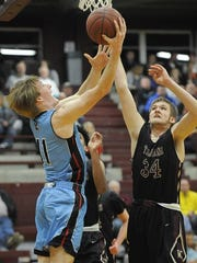 Union County's Logan Thomas goes to the hoop past Webster's