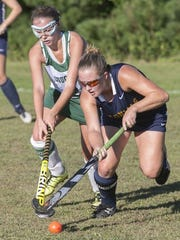 Field hockey Freehold Boro at Colts Neck. Colts Neck #2 Lea Vecchiarelli (left) and Boro #4 Tori Tiefenthaler fight for the ball —October 6, 2016-Colts Neck, NJ.-Staff photographer/Bob Bielk/Asbury Park Press