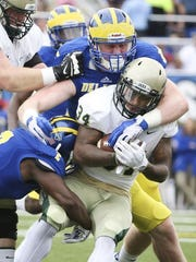 Maurice Harley (2) and John Nassib combine for a tackle on William and Mary's Nate Evans in Delaware's 17-0 win last month at Delaware Stadium.