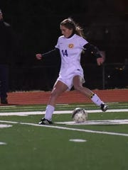 Byrd's Eva Paul drives the ball.