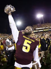 Manny Wilkins hoists the Territorial Cup.