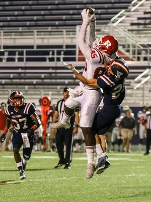 Ruston's Ray Parker goes up for a catch against West Monroe.